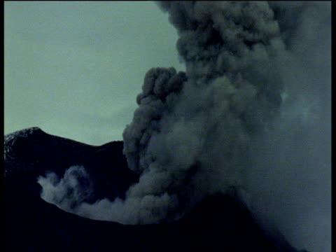 Volcano spews smoke and ash.