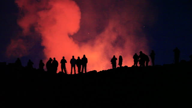 volcano tourists watching the eruption at the fimmvorduhals region of the eyjafjallajokull volcano in iceland. - tourist stock videos & royalty-free footage