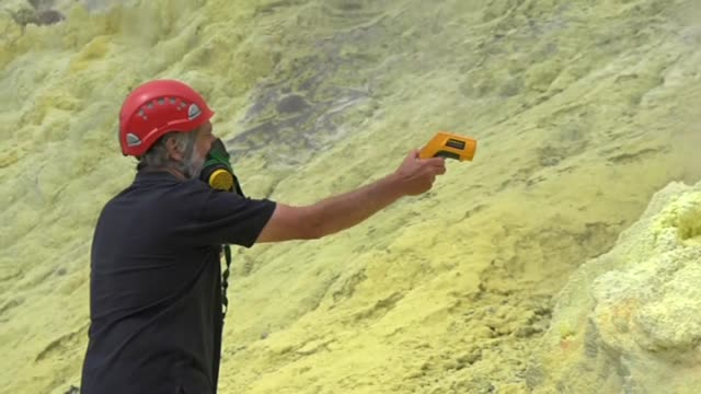 volcanologist measuring geothermal levels of white island volcano in sea off whakatane bay of plenty new zealand - tectonic stock videos & royalty-free footage