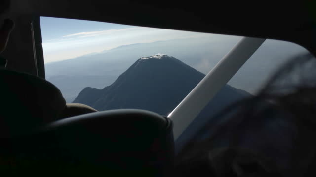 volcán de colima from the air erupting - airplane part stock videos and b-roll footage