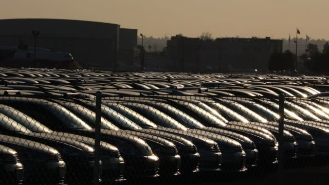 Volkswagen AG and Audi AG turbo diesel injection cars recalled as part of a buyback program stand parked in a storage lot at San Bernardino...