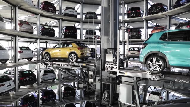 volkswagen cars lie deposited in one of the twin car towers at the volkswagen autostadt visitors center on december 4 2018 in wolfsburg germany... - wolfsburg lower saxony stock videos and b-roll footage