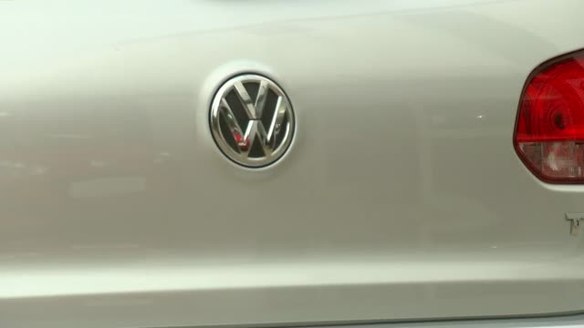 falsifying of exhaust test results may also have happened in europe england ext various shots of volkswagen cars on display on forecourt of vw car... - バッジ点の映像素材/bロール