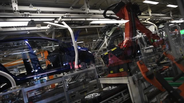 volkswagen golf cars are displayed at a assembly line at the volkswagen factory on march 8, 2018 in wolfsburg, germany. u.s. president donald trump... - 関税点の映像素材/bロール