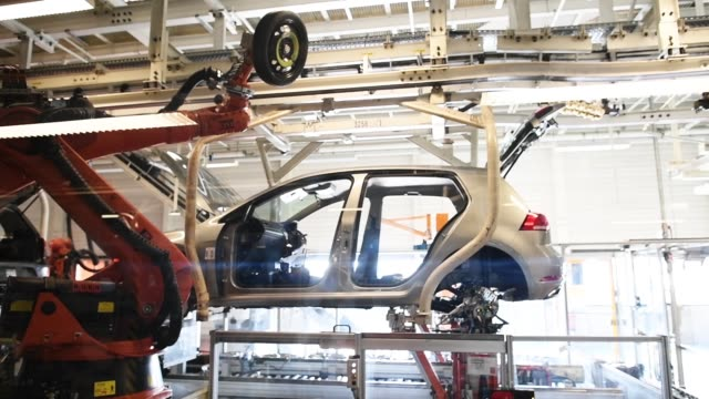 volkswagen golf cars are displayed at a assembly line at the volkswagen factory on march 8 2018 in wolfsburg germany us president donald trump has... - riff stock videos & royalty-free footage