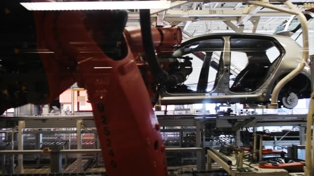 volkswagen golf cars are displayed at a assembly line at the volkswagen factory on march 8 2018 in wolfsburg germany us president donald trump has... - tariff stock videos & royalty-free footage
