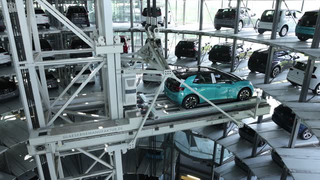 """volkswagen id.3 electric cars stand in the storage tower following assembly at the """"gläserne manufaktur"""" production facility on june 08 in dresden,... - electricity stock videos & royalty-free footage"""