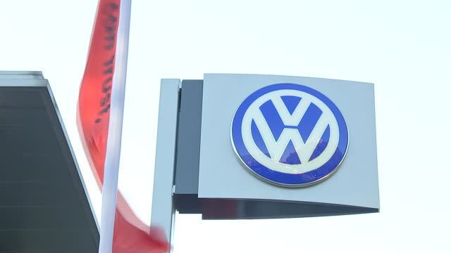 volkswagen reports first quarterly losses in 15 years following emissions scandal vw sign at showroom forecourt int '20 tdi' logo on car boot pull... - logo stock videos & royalty-free footage