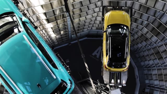 a volkswagen tcross and a volkswagen troc are presented in one of the twin car towers at the volkswagen autostadt visitors center on december 4 2018... - wolfsburg lower saxony stock videos and b-roll footage