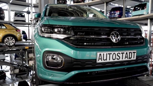 a volkswagen tcross is presented in one of the twin car towers at the volkswagen autostadt visitors center on december 4 2018 in wolfsburg germany... - wolfsburg lower saxony stock videos and b-roll footage
