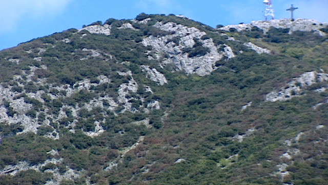 volperino italy tilt down of mount pozzo to a monastery nestled in the cliff face - rock face stock videos & royalty-free footage