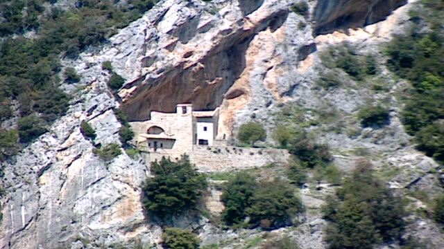 volperino italy view of a monastery built into the cliff face of mount pozzo - rock face stock videos & royalty-free footage