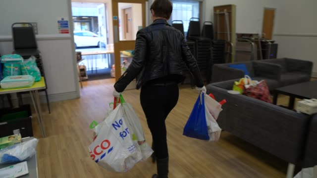 volunteer from ealing soup kitchen prepares food parcels for clients on march 30, 2020 in london, england.the coronavirus pandemic has spread to many... - soup kitchen stock videos & royalty-free footage