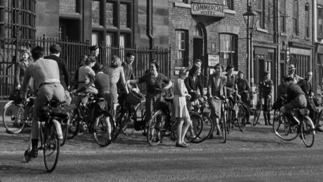montage volunteer land club members meet and bike off to do farm work / united kingdom - 1943 stock videos & royalty-free footage