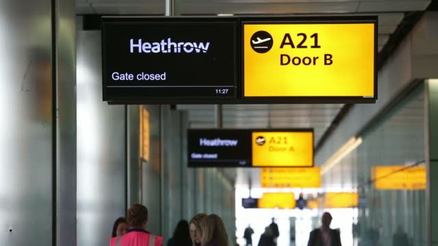 volunteer passengers wait in the airport departures hall during a test day ahead of opening at heathrow airport new terminal 2 facility in london uk... - hanging sign stock videos and b-roll footage