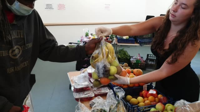 volunteer provides fruit to a local resident at the albrighton community centre which partners with environmental charity hubbub to create the... - fruit stock videos & royalty-free footage