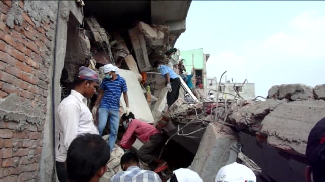 volunteer rescuers from the bangladesh factory collapse are haunted by the trauma including mamun who cannot forget the memory of sawing off a young... - dhaka stock-videos und b-roll-filmmaterial