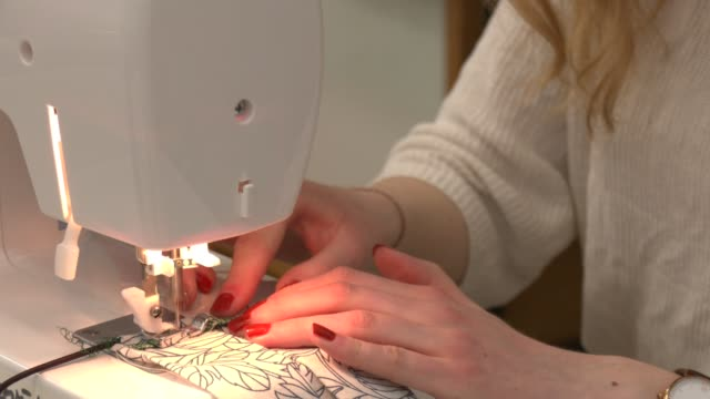 a volunteer sews masks for homeless project by the berliner stadtmission charitable organization on april 9 2020 in berlin germany the berliner... - sewing machine stock videos & royalty-free footage