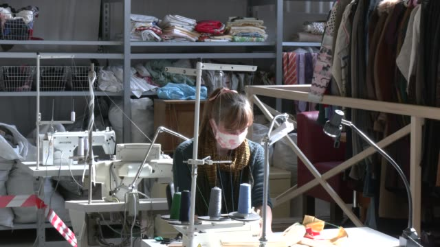 stockvideo's en b-roll-footage met volunteer sews masks for homeless, project by the berliner stadtmission charitable organization on april 9, 2020 in berlin, germany. the berliner... - number 9