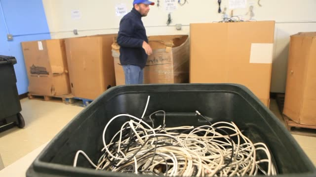 a volunteer sorts cables at the university of san diego ewaste center in san diego california us volunteers sort used electronics by categories... - e waste stock videos & royalty-free footage