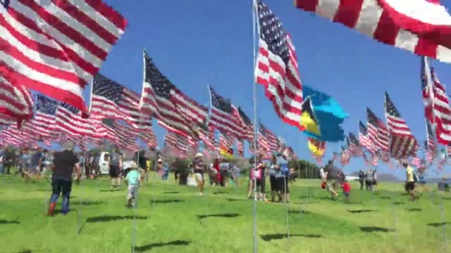 volunteers and cadets install the september 11 memorial flags at pepperdine university on september 10th, 2016. - memorial stock videos & royalty-free footage