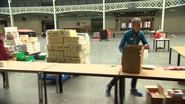 volunteers assisting at the hammersmith and fulham food bank during the coronavirus crisis - packing stock videos & royalty-free footage