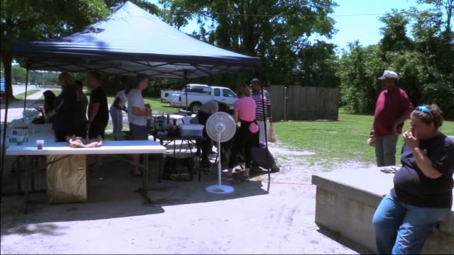 volunteers at goldsboro community soup kitchen give haircuts to homeless people. - soup kitchen stock videos & royalty-free footage