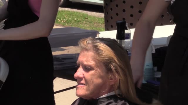 volunteers at goldsboro community soup kitchen give haircuts to homeless people - soup kitchen stock videos & royalty-free footage