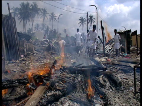 Volunteers burn piles of wreckage left by tsunami Sri Lanka 4 Jan 05