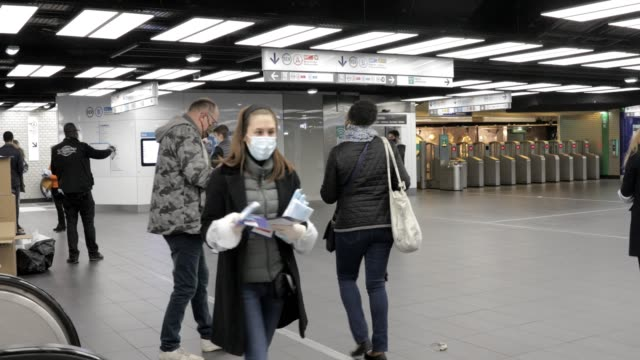 volunteers distribute facial masks and leaflets, offered by the ile de france region, to commuters at the rer chatelet les halles metro station in... - public transport stock videos & royalty-free footage
