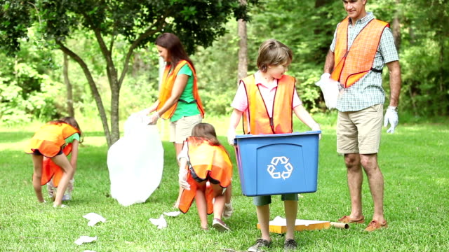 volunteers: family cleans up their community park. recycling bin. - environmental cleanup stock videos and b-roll footage