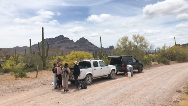 volunteer's for the humanitarian aid organization no more deaths prep for delivery of water along a trail used by undocumented immigrants in the... - human face video stock e b–roll