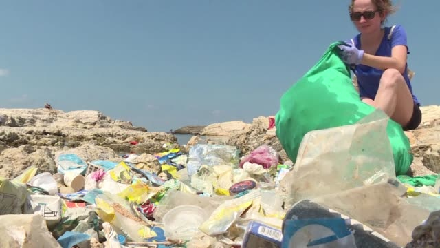 Volunteers garbage bag in hand gather to clean up one of the last public beaches in Beirut
