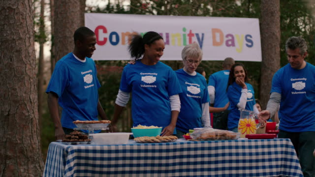 volunteers gather for community picnic - altruism stock videos & royalty-free footage