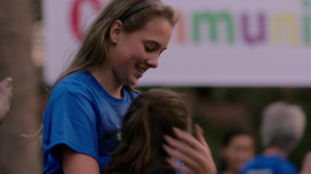 volunteers gather for community picnic - volunteer stock videos & royalty-free footage