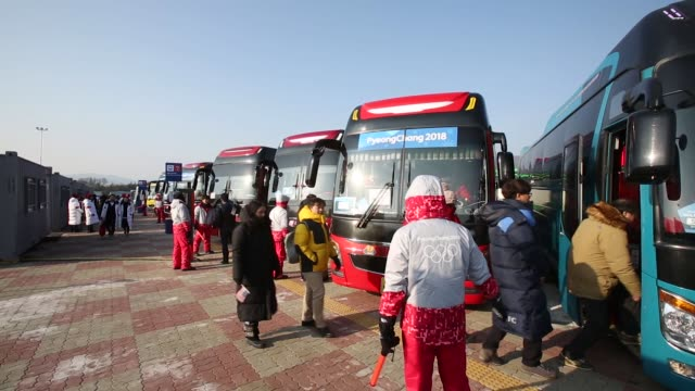 volunteers give visitors directions to shuttle buses for the olympic stadium ahead of the 2018 pyeongchang winter olympic games in the hoenggyeri... - winter olympic games stock videos and b-roll footage