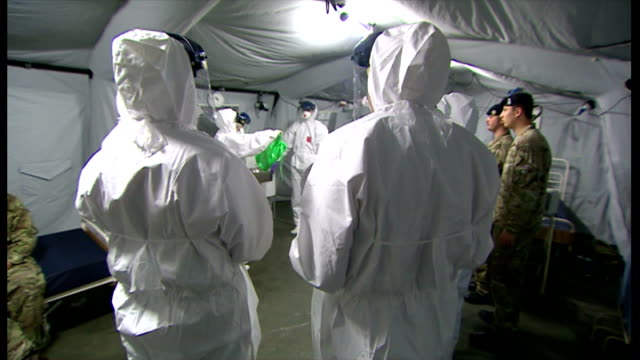 Volunteers in Ebola Training Unit Interior shots of NHS volunteers in Ebola exercise project mock quarantine unit NHS staff receiving Ebola training...