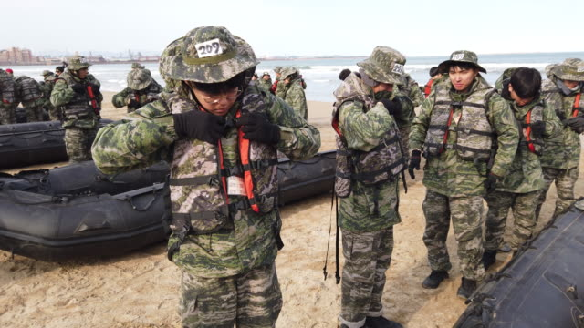 volunteers in front of boats during marine's winter training camp course at pohang seashore military base on january 14 2020 in pohang south korea... - marines military stock videos & royalty-free footage