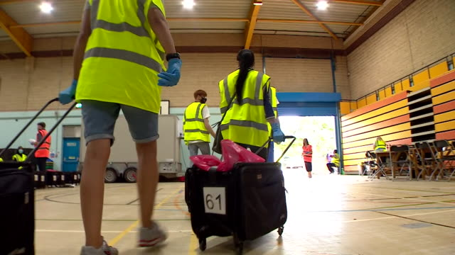 volunteers in leicester packing up coronavirus tests to take door to door whilst the city is on local lockdown due to a rise in cases - leicestershire stock videos & royalty-free footage
