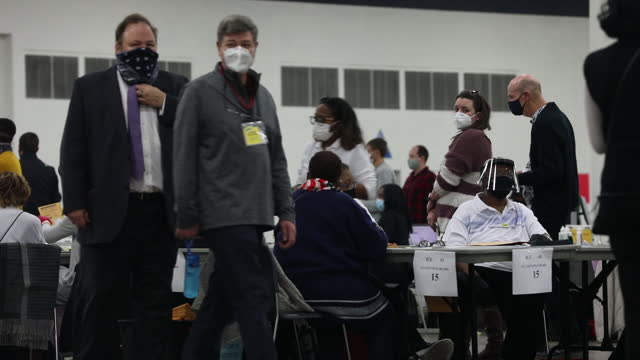 volunteers in masks and face shields during counting absentee ballots at tcf center in detroit, michigan, u.s., wednesday, november 4, 2020. - ballot slip stock videos & royalty-free footage