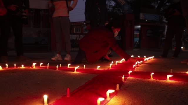 volunteers of maiti nepal light candles to mark the eve of world aids day, in kathmandu, on monday, november 30, 2020. maiti nepal is an organization... - retrovirus stock videos & royalty-free footage