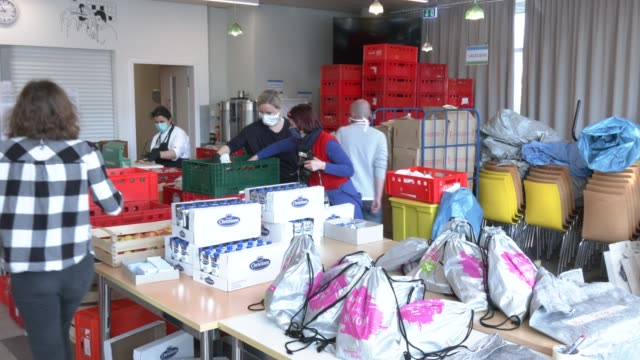volunteers pack emergency food packages for distribution to the homeless in a project by the berliner stadtmission charitable organization on april... - charity benefit stock videos & royalty-free footage
