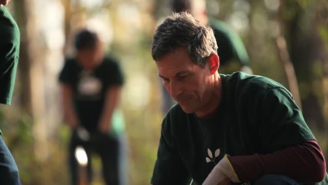 volunteers planting trees - planting stock videos & royalty-free footage
