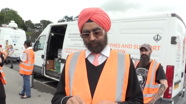 volunteers provide aid to residents of whaley bridge after it was feared toddbrook reservoir dam would collapse. interviews with pritpal singh maken... - derbyshire stock-videos und b-roll-filmmaterial