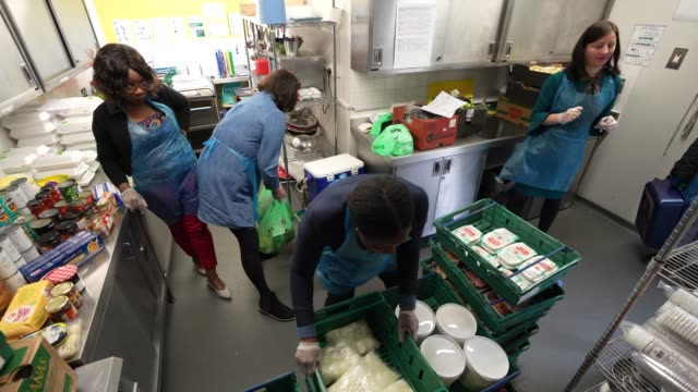 volunteers sort and pack food donations to go out on delivery to homes in need homestart is a local community network of trained volunteers and... - charity and relief work stock videos & royalty-free footage
