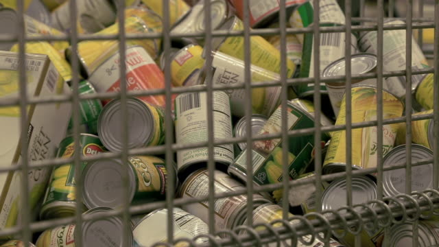 volunteers sort donated food at the capital area food bank - canned food stock videos & royalty-free footage