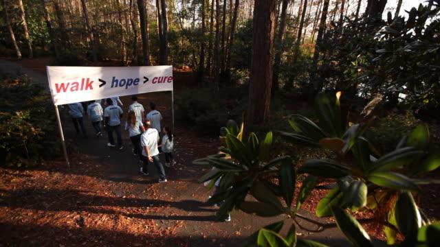 Volunteers walk away under charity banner