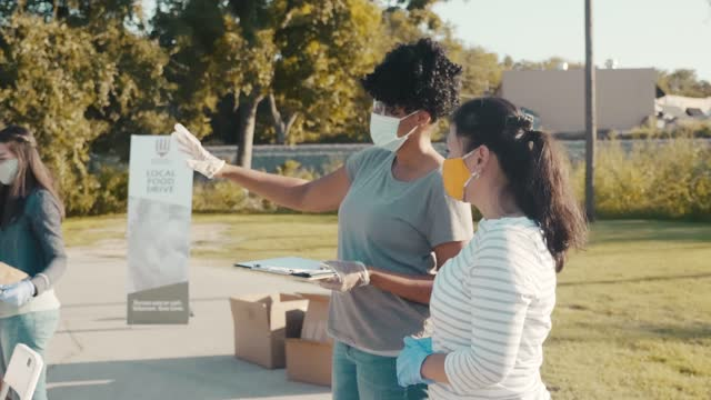 volunteers working during food drive - charity benefit stock videos & royalty-free footage