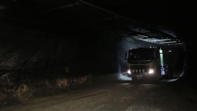 volvo autonomous fmx self driving truck, manufactured by volvo group, drives through underground tunnels, at kristineberg mine in the boliden area in... - independence video stock e b–roll
