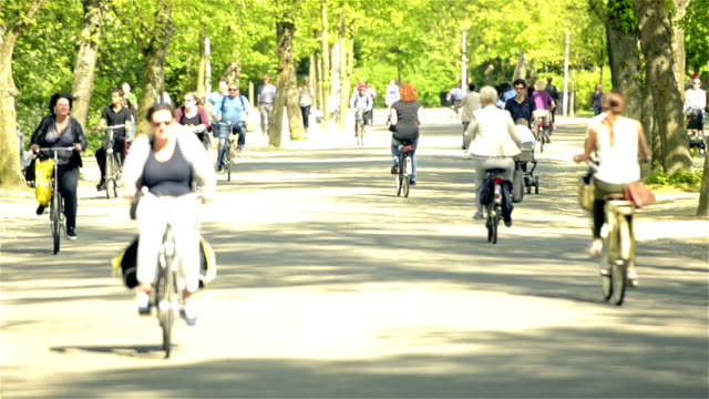 vondelpark amsterdam and the cyclists - amsterdam stock videos & royalty-free footage